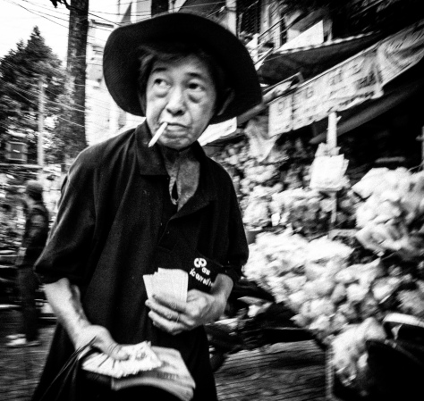 Ticket seller. Cho Lon district of Saigon, 2014.