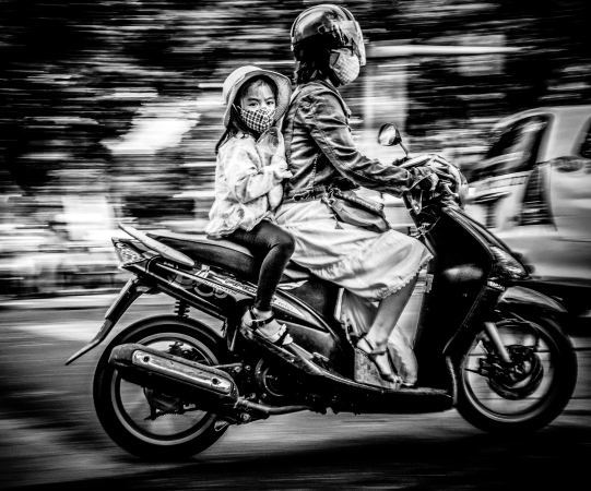 Girl on a bike. Saigon, 2014.