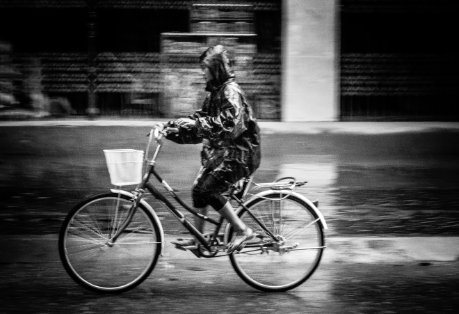 Cyclist in the rain. Bac Ha, Vietnam 2012.