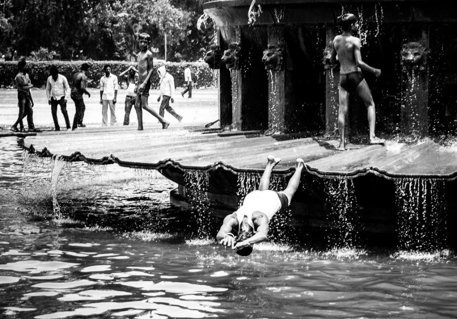 Boys swimming India Gate Delhi